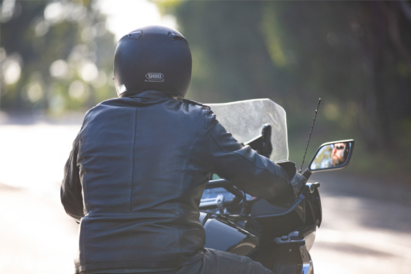Motorcyclist travelling on the road