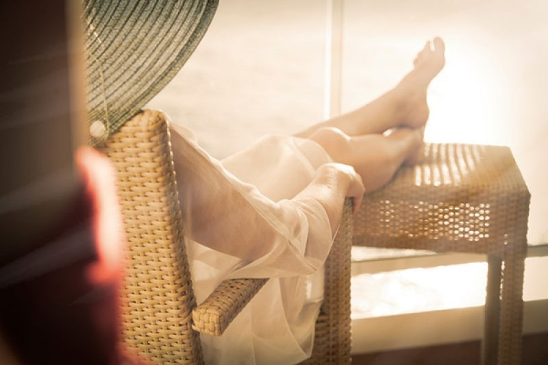 Woman relaxing on a cruise in the sun