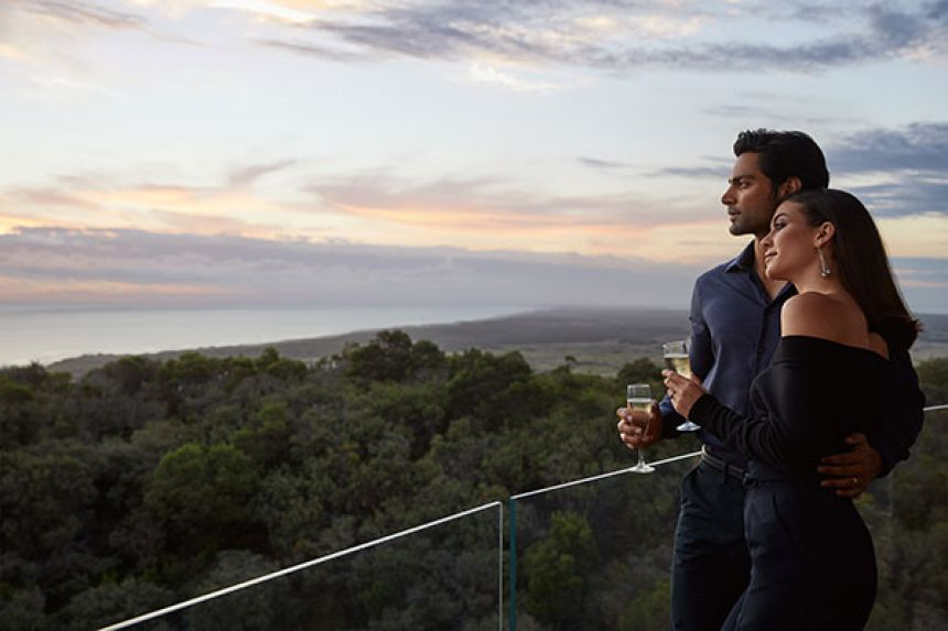 Couple drinking champagne on balcony