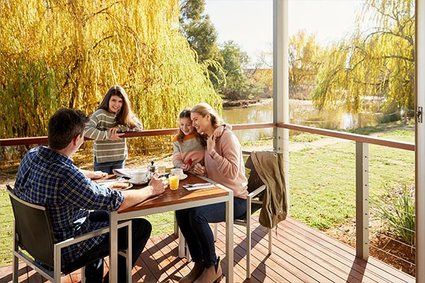 Family on cabin terrace at RACV Cobram Resort